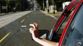 throw_cigarette_butt_driving_littering_nea_lta_singapore_0